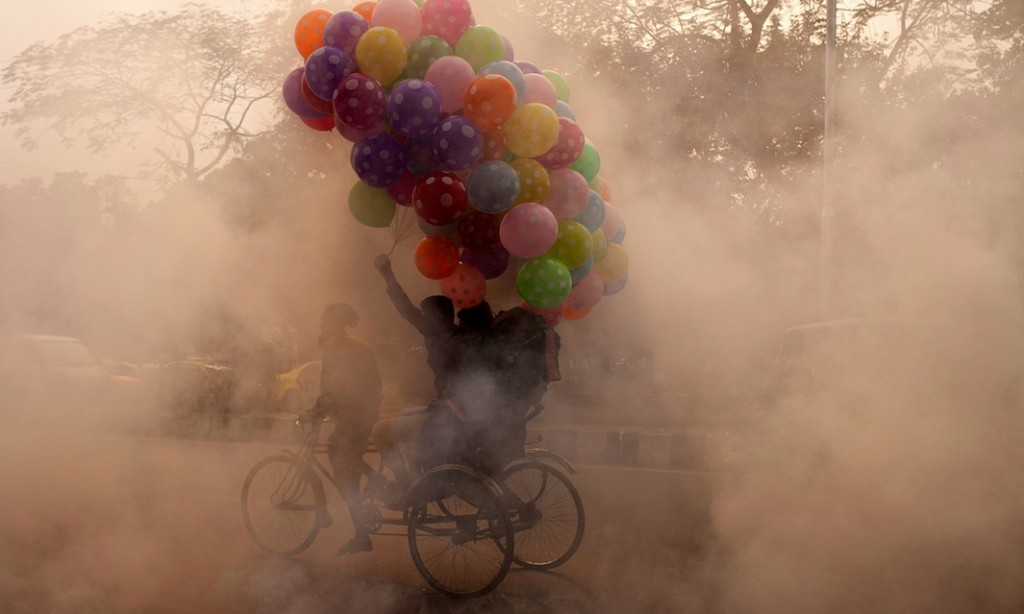 A rickshaw puller on a polluted a street in Dhaka, Bangladesh. Photograph: Zakir Hossain Chowdhury/Barcro
